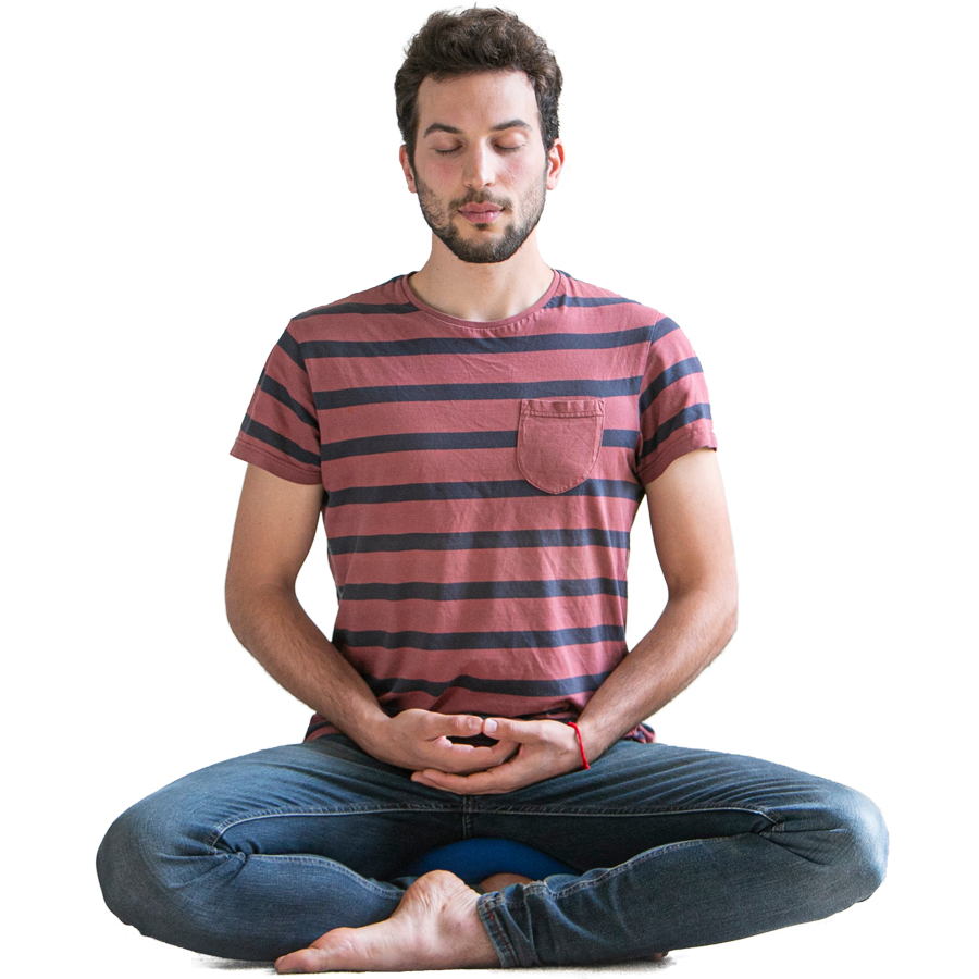 A young man in a striped t-shirt meditating
